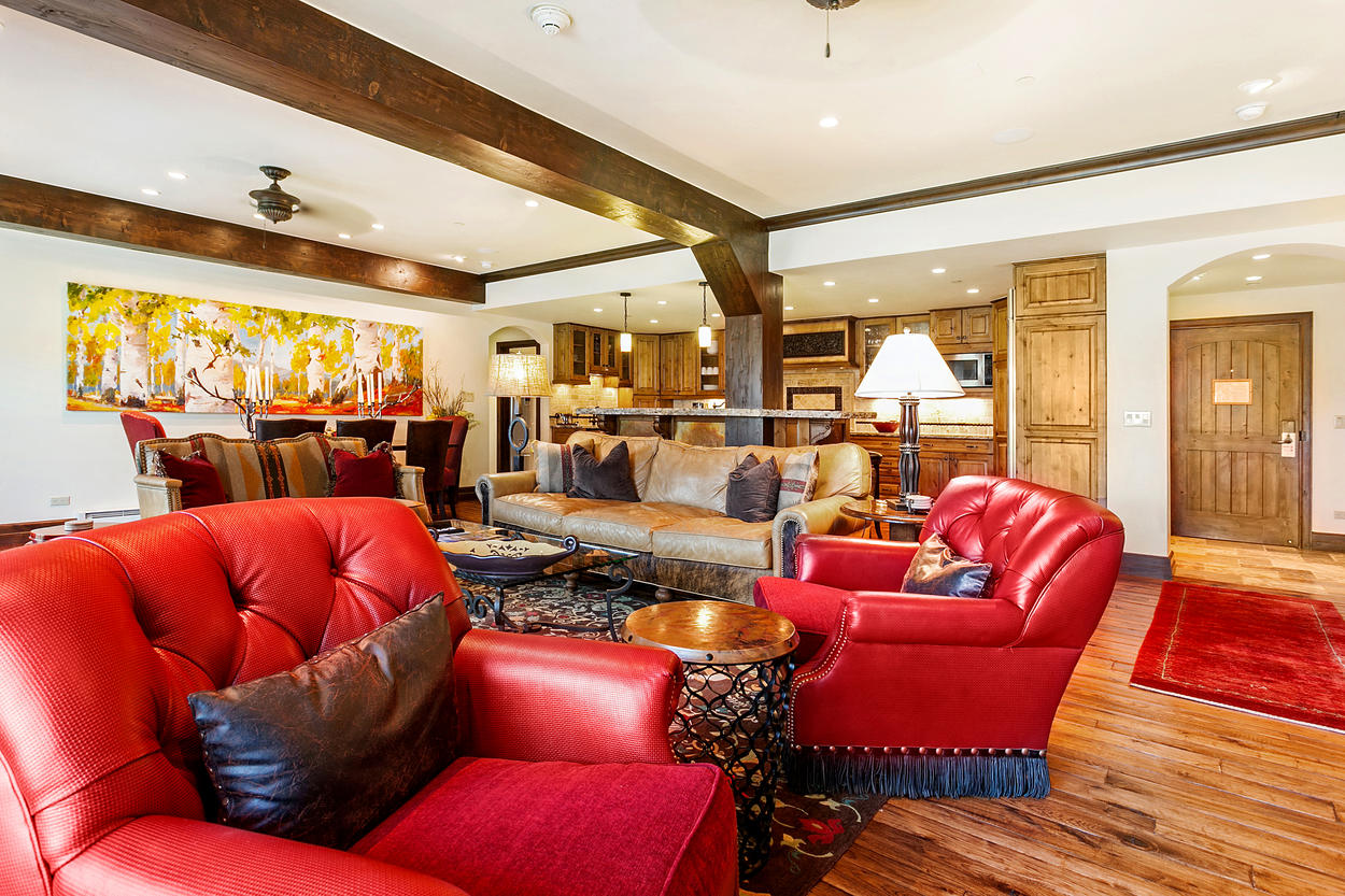 Massive exposed wood beams give this lavish room a slightly rustic look.