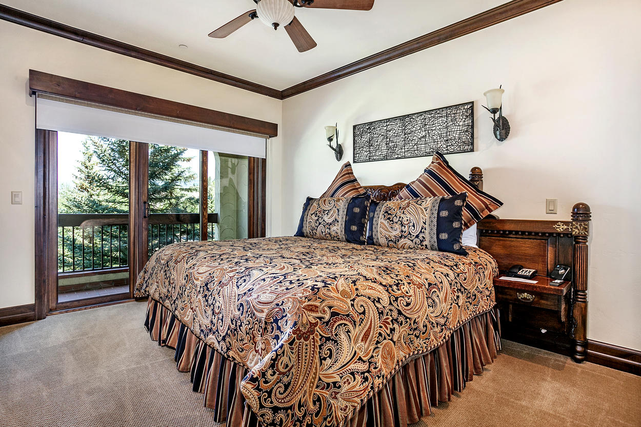 The lavish Master Bedroom has a king-size bed and an attached ensuite bathroom.