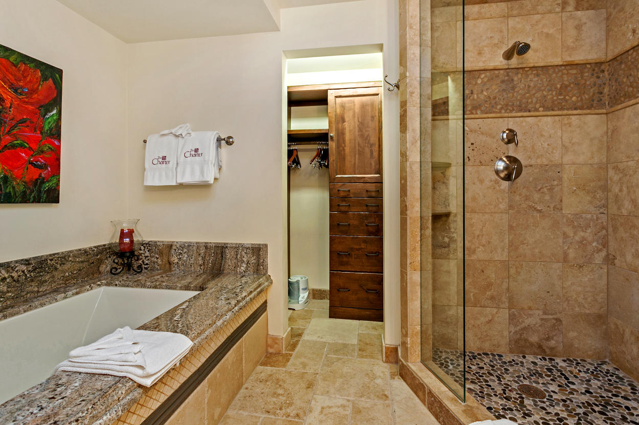 The ensuite features it's own stand-alone tub, walk-in shower, and large closet.