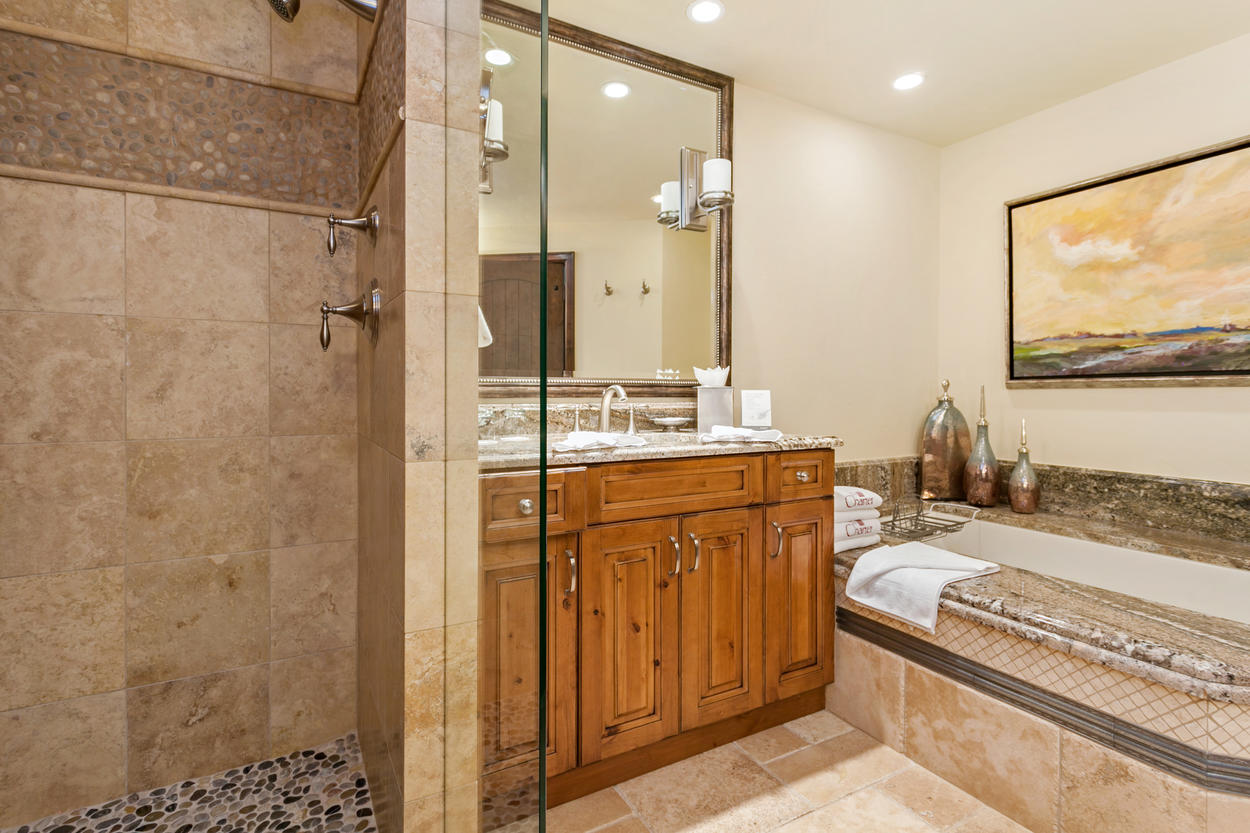 The Master Bathroom has a luxurious tub and walk-in shower.