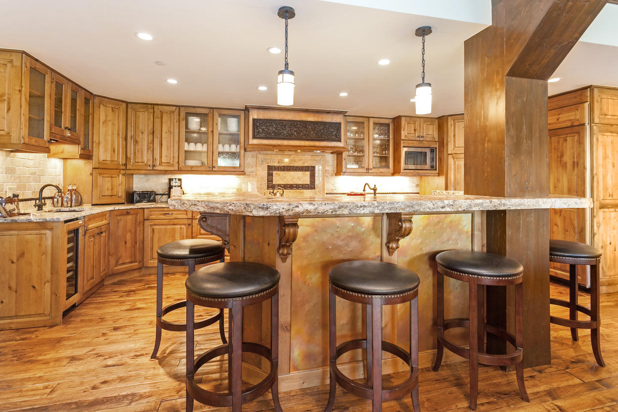 There's seating for six at the kitchen island breakfast bar.