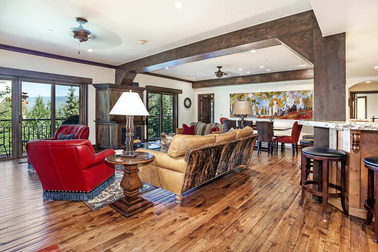 The open concept design brings together the living room, dining area, and kitchen.