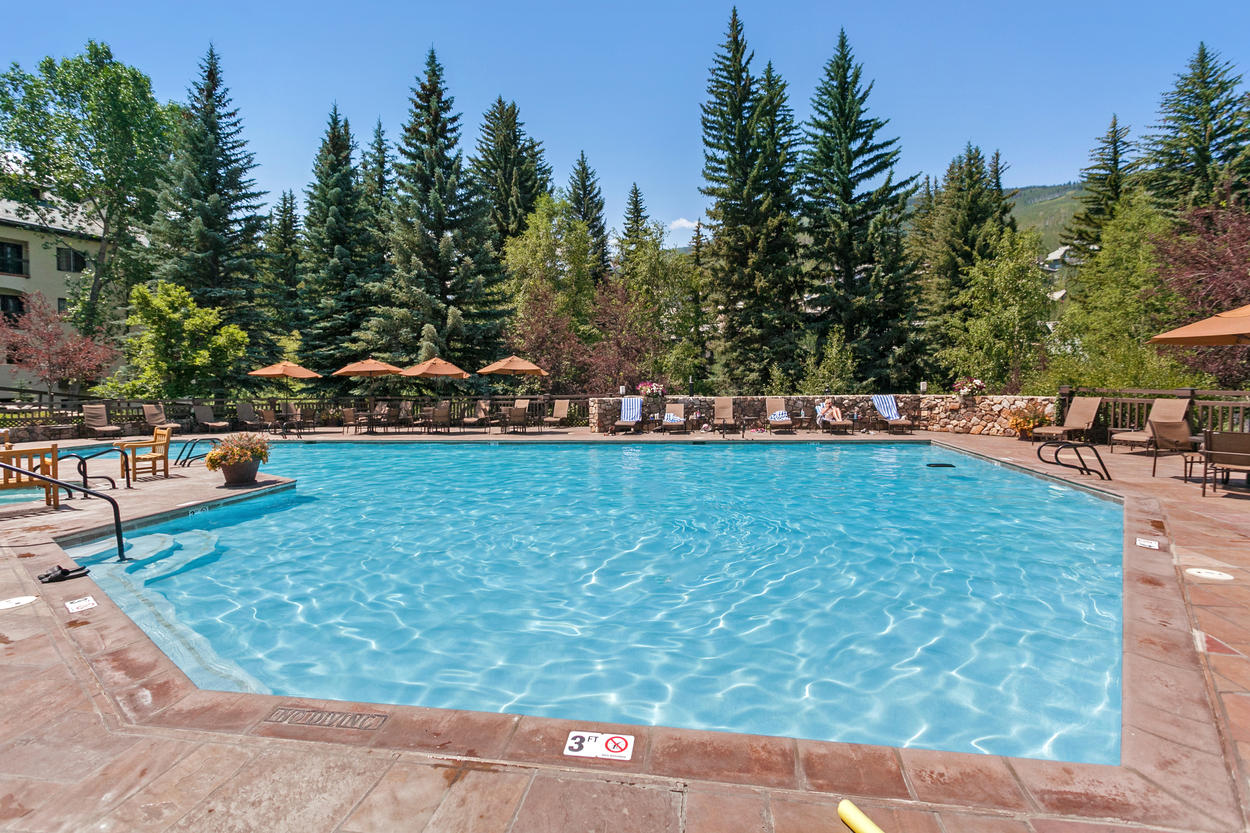 Enjoy the spectacular mountain setting of the shared outdoor pool.