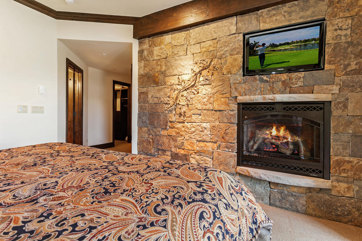 In the Master Bedroom, enjoy watching TV from your bed, or relax in the glow of the gas fireplace.