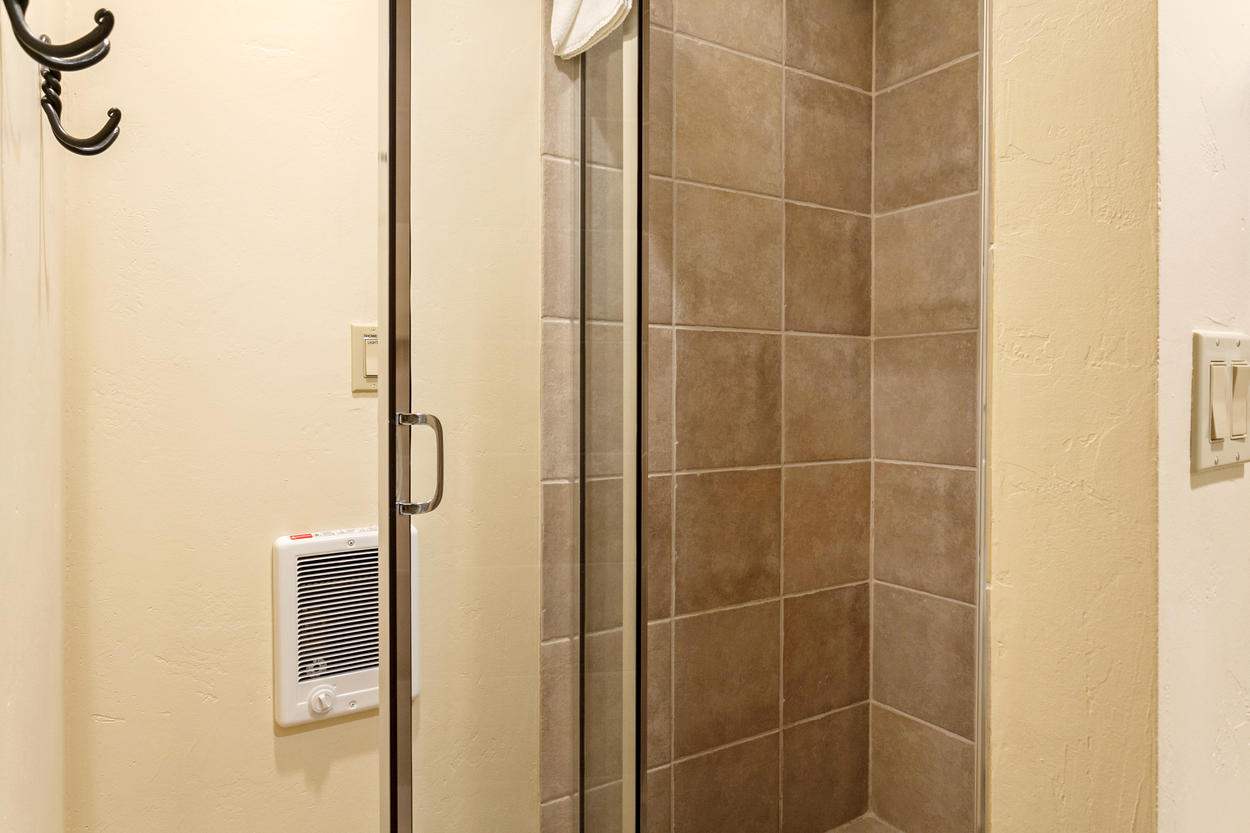 The attached ensuite for Guest Bedroom 3 has a stand-alone shower.