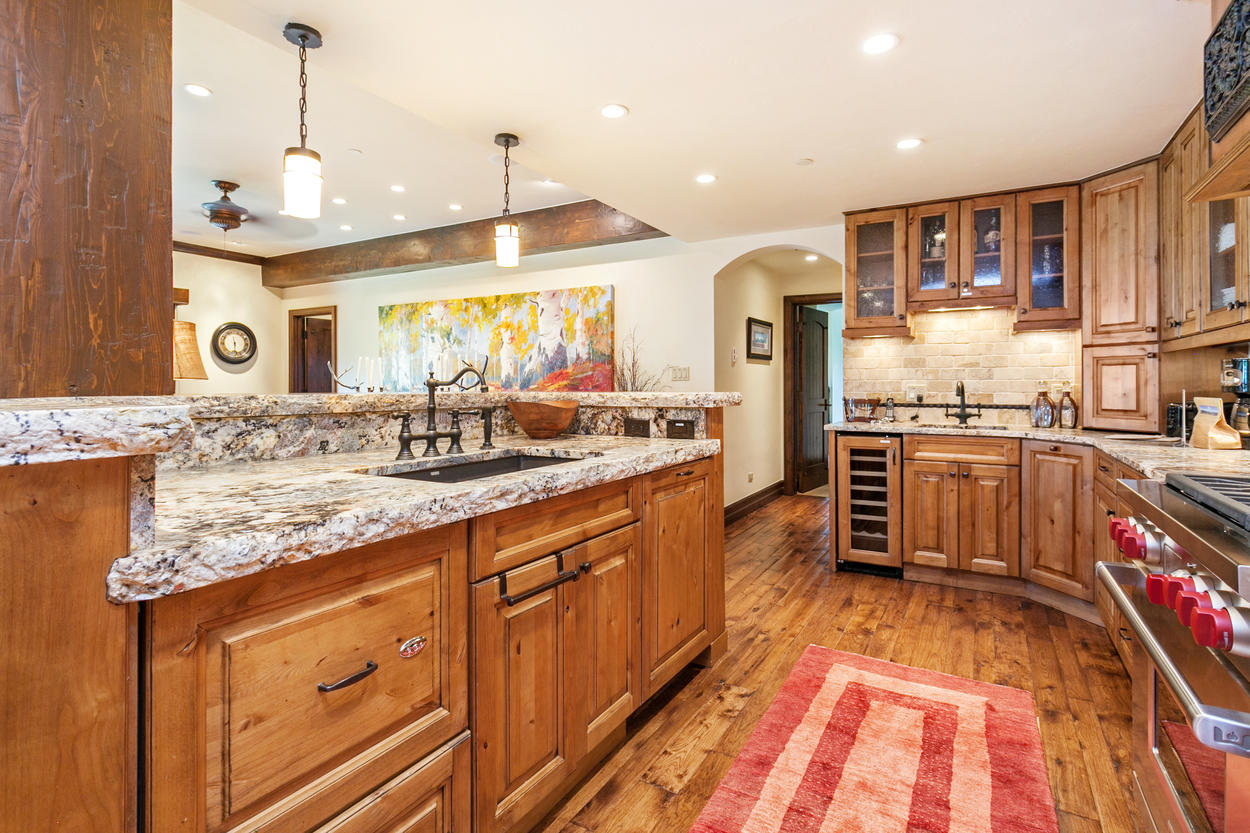 Granite countertops with chiseled edges line the entire kitchen.