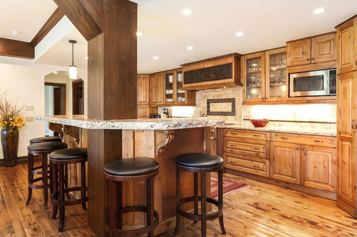 The tile backsplash adds to the elegance of the kitchen.