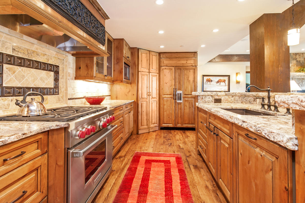 Custom wood panels cover many of the amenities, including the refrigerator and dishwasher.