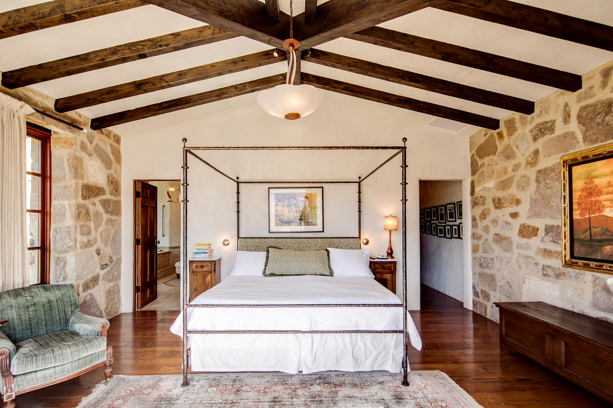 The Master Suite in the main house has a king-size bed and authentic European furniture.