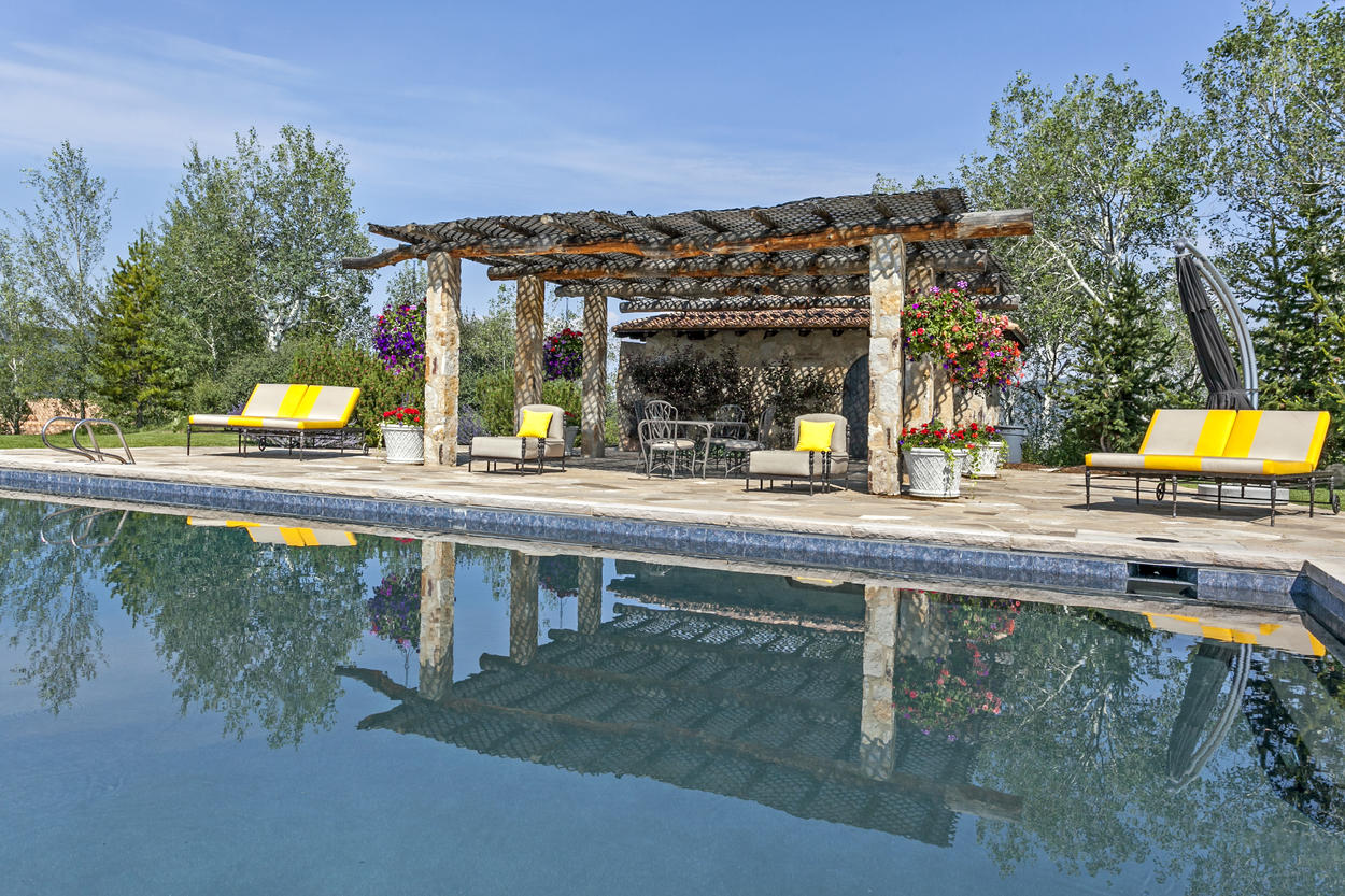 The pool house and pergola rival those found in the world's finest hotels.