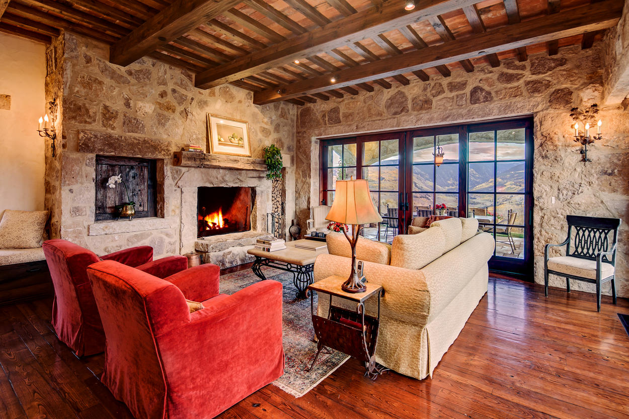 This same sitting area makes for a cozy refuge in the winter, with a fireplace and plush seating options.