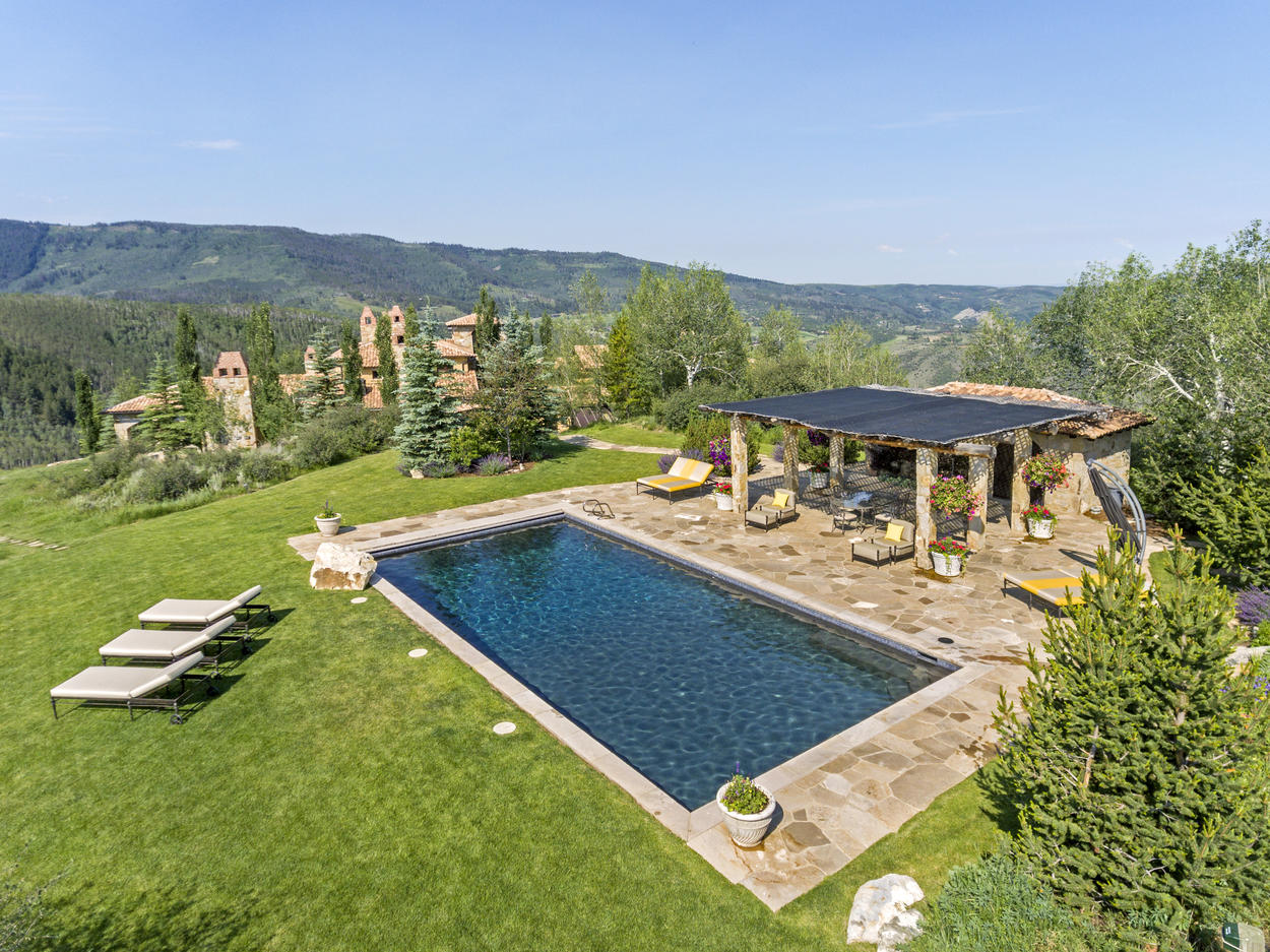 The pool and pool house are located just up a small hill near the main house.