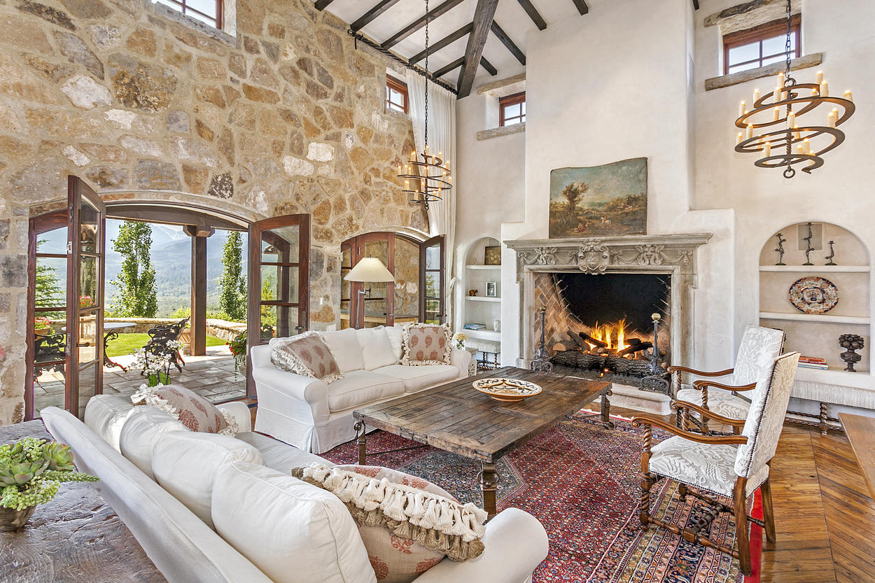 The living room in the main house features an authentic 16th-century Italian fireplace and beautiful furnishings.