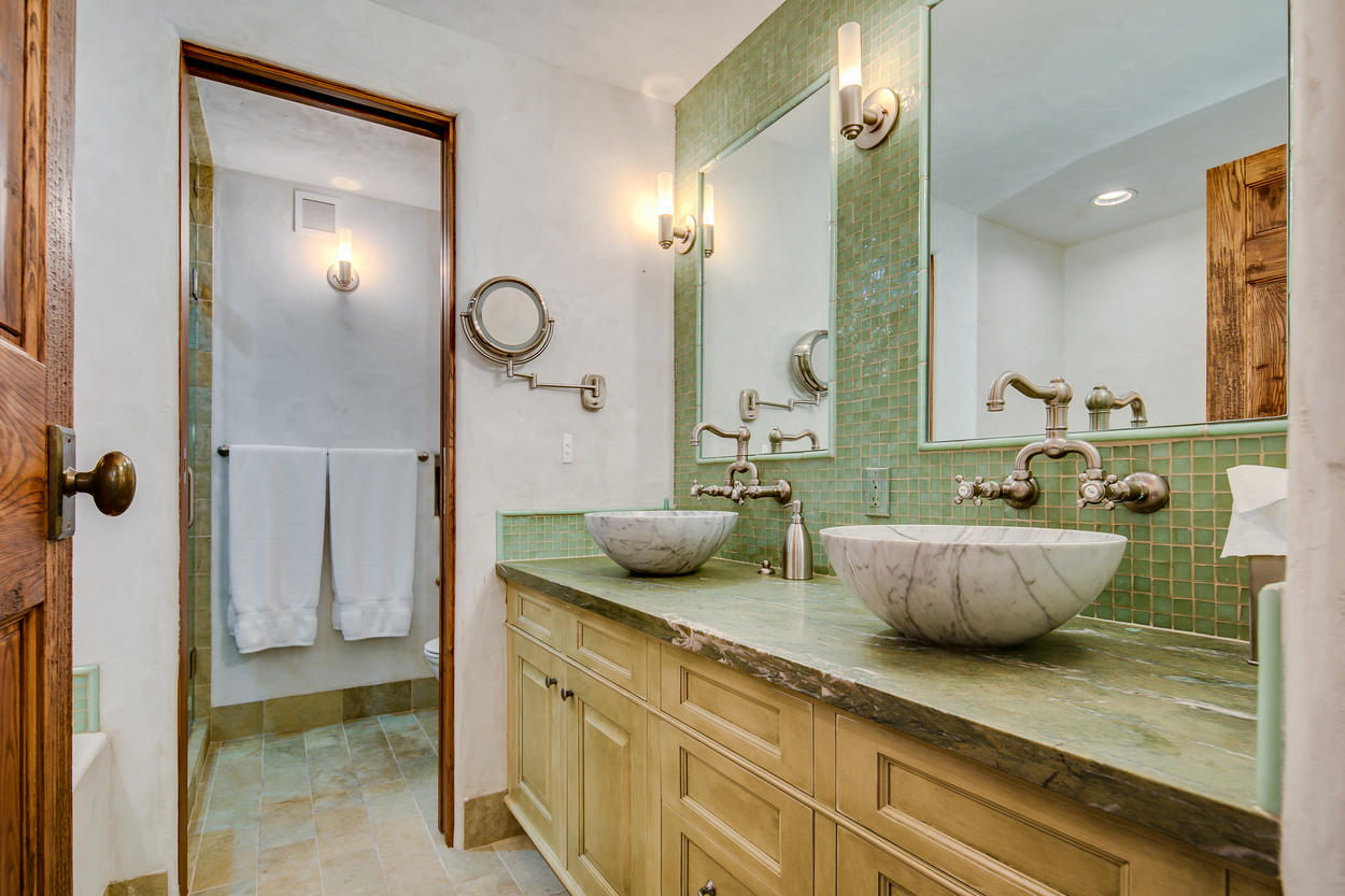 Traditional European faucets add authenticity to the guest bathroom.