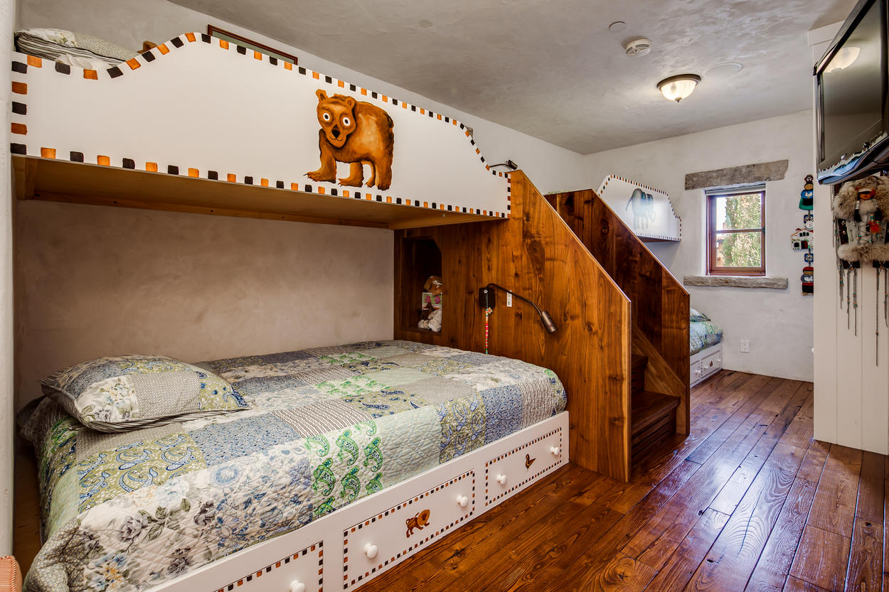 The bunk room features two sets of bunks, each with a twin-over-full setup.