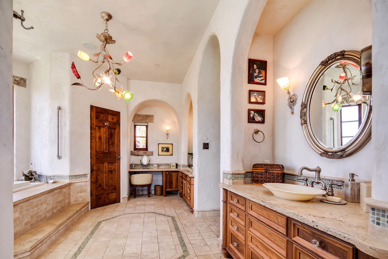 The Master Bathroom has a sitting nook and a large, deep soaking tub.