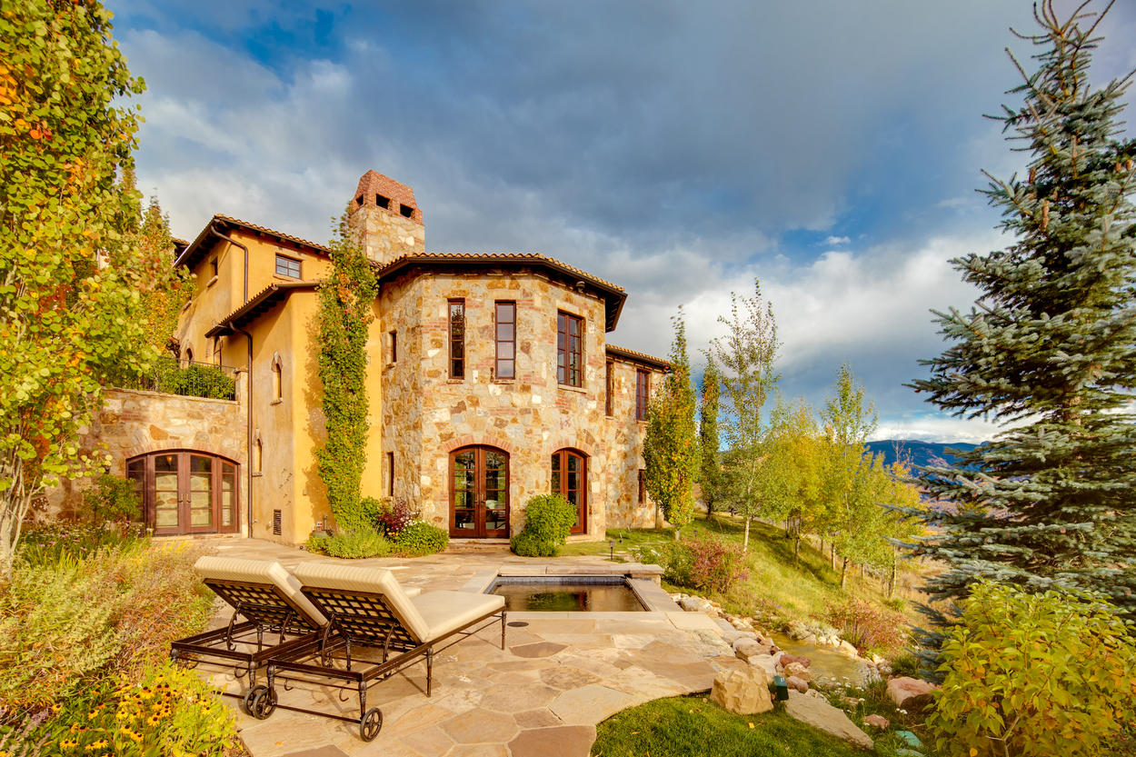 Pines and aspens remind you you're still in Colorado despite the home's Italian design.