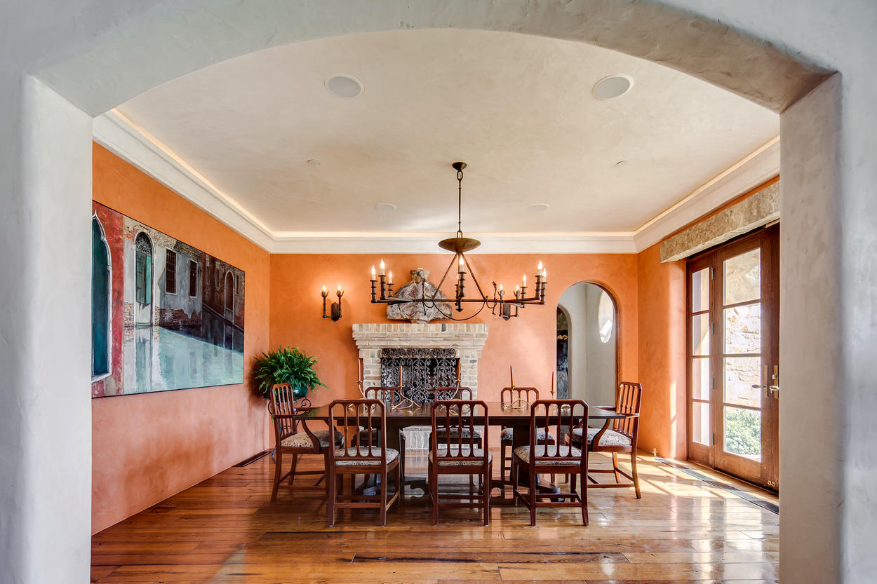 The formal dining room has a fireplace and a dining table that seats 12 guests.