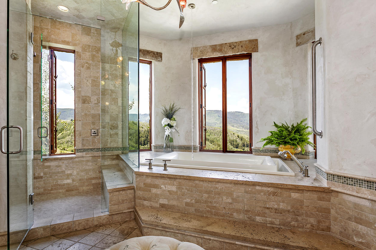 Notice the stream of water coming from the ceiling: a truly one of a kind bathing experience.