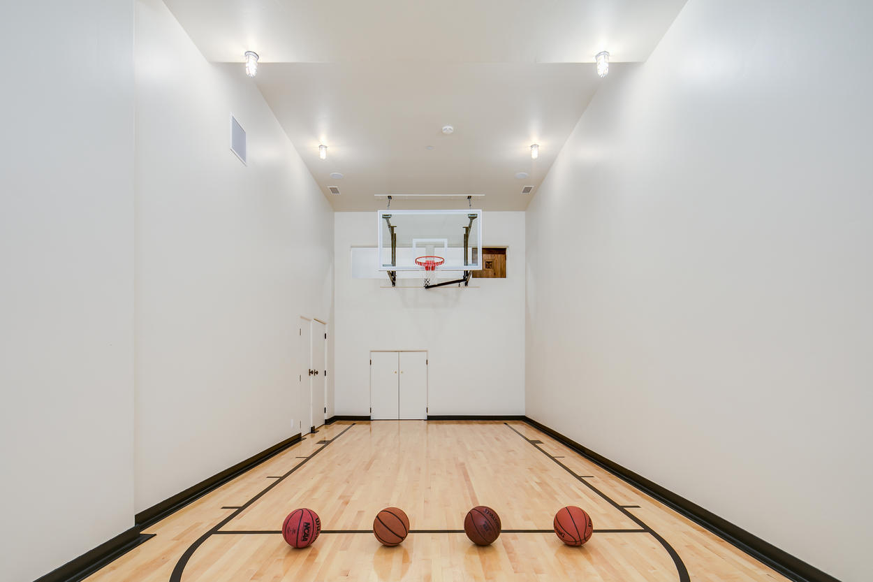 On the lowest level of the home there's an indoor basketball court.