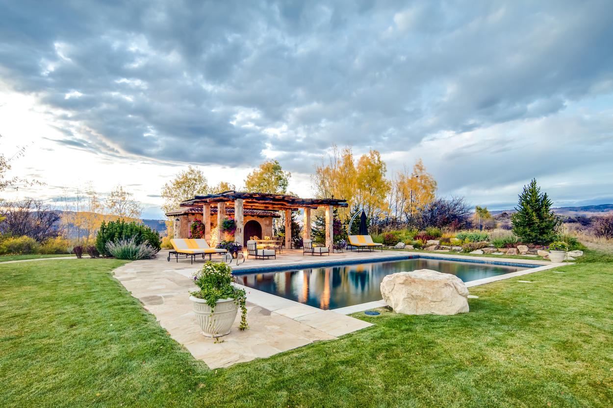 The seasonal summer pool is heated, and sits on top of a hill on the property.