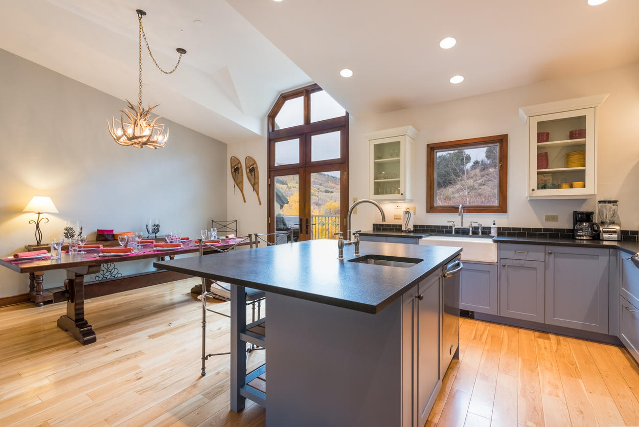 The stylish kitchen offers a farmhouse sink and stainless appliances throughout.