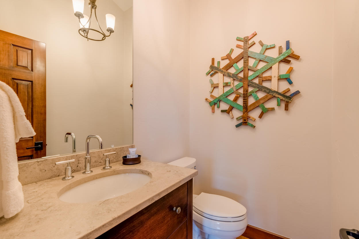 A powder room is located on the living area level for convenience.