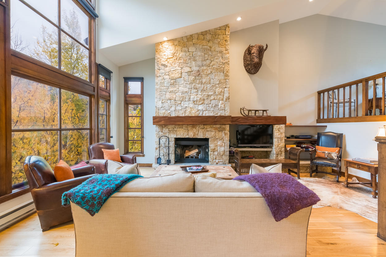 Enjoy a show on tv or a wood fire in the handcrafted fireplace.