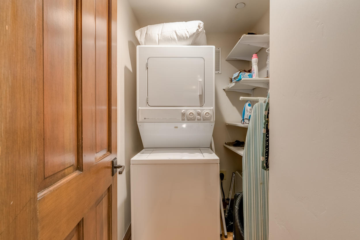 The laundry closet features a stacked washer/dryer combo.