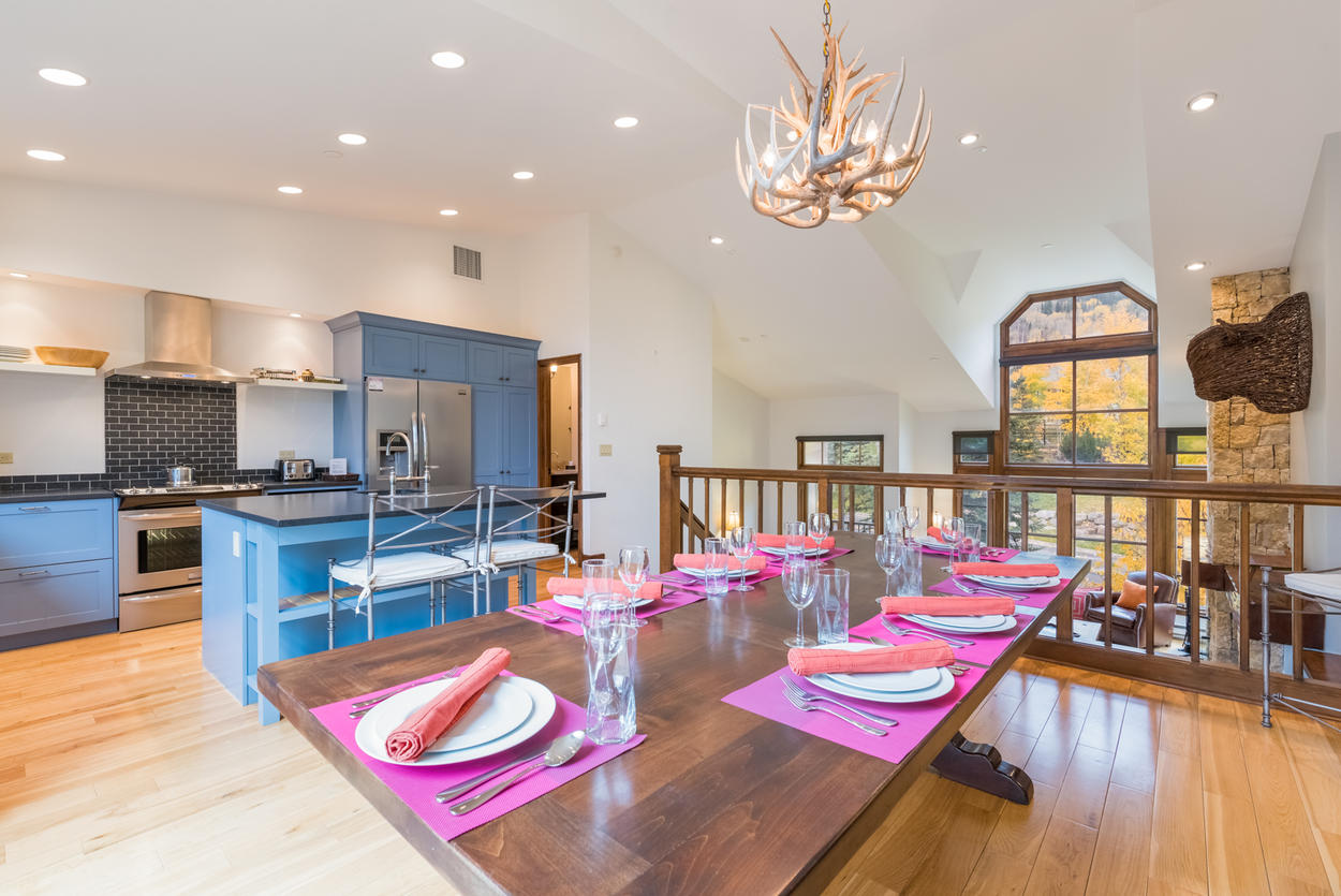 The upper level hosts a beautiful kitchen and dining area.