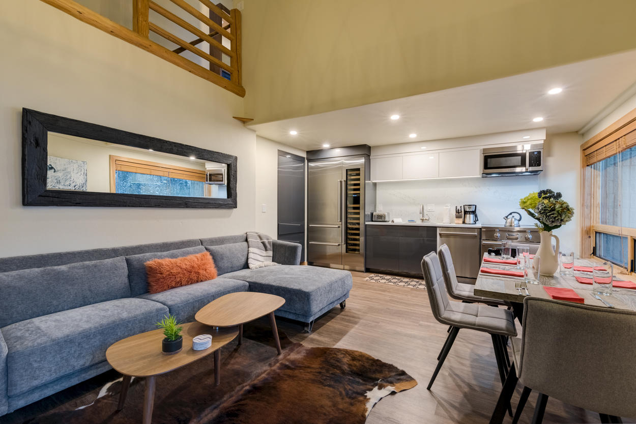 The fully-equipped kitchen and modern dining space blend perfectly into the living room on the main level