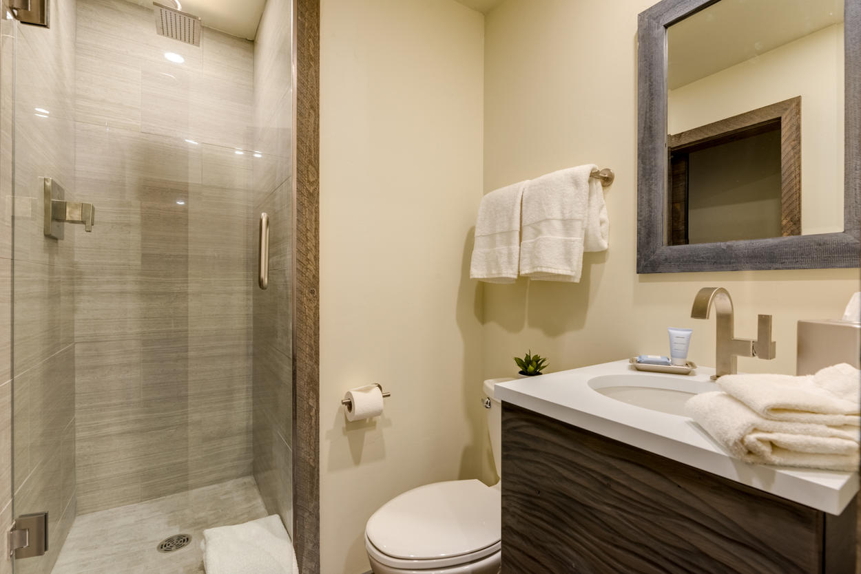 The ensuite for the Bunk Room has a walk-in shower and more modern fixtures and finishes