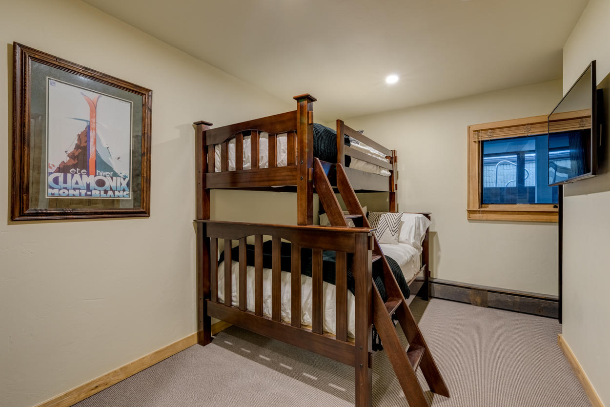 The captain's bunk in Guest Bedroom 3 features a twin over a full-sized bed