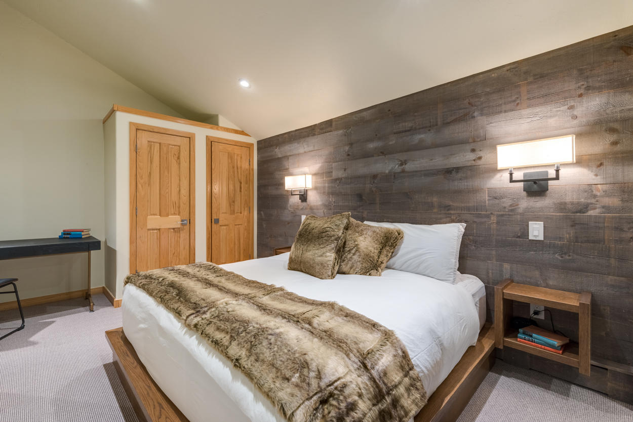 Upstairs, the Master Bedroom hosts a king bed and modern lighting