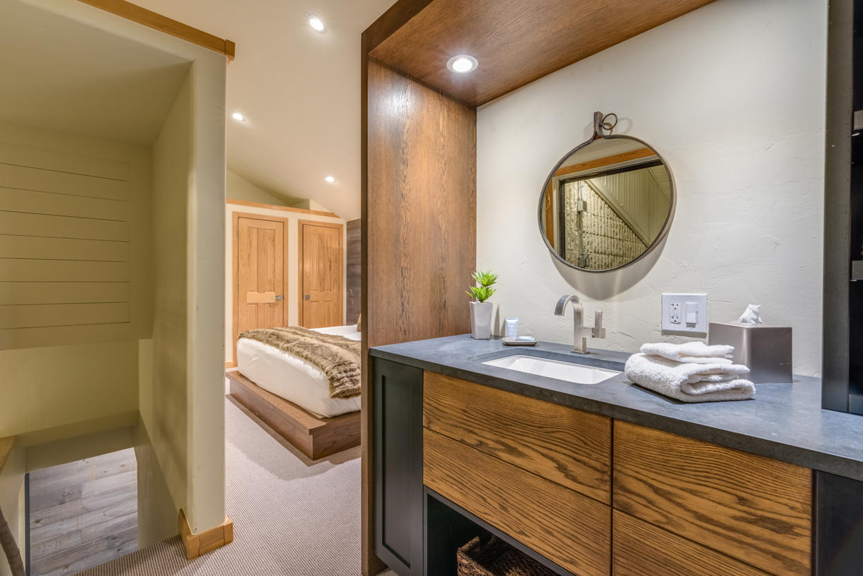 There's a dual-purpose vanity and wet bar in the master bedroom