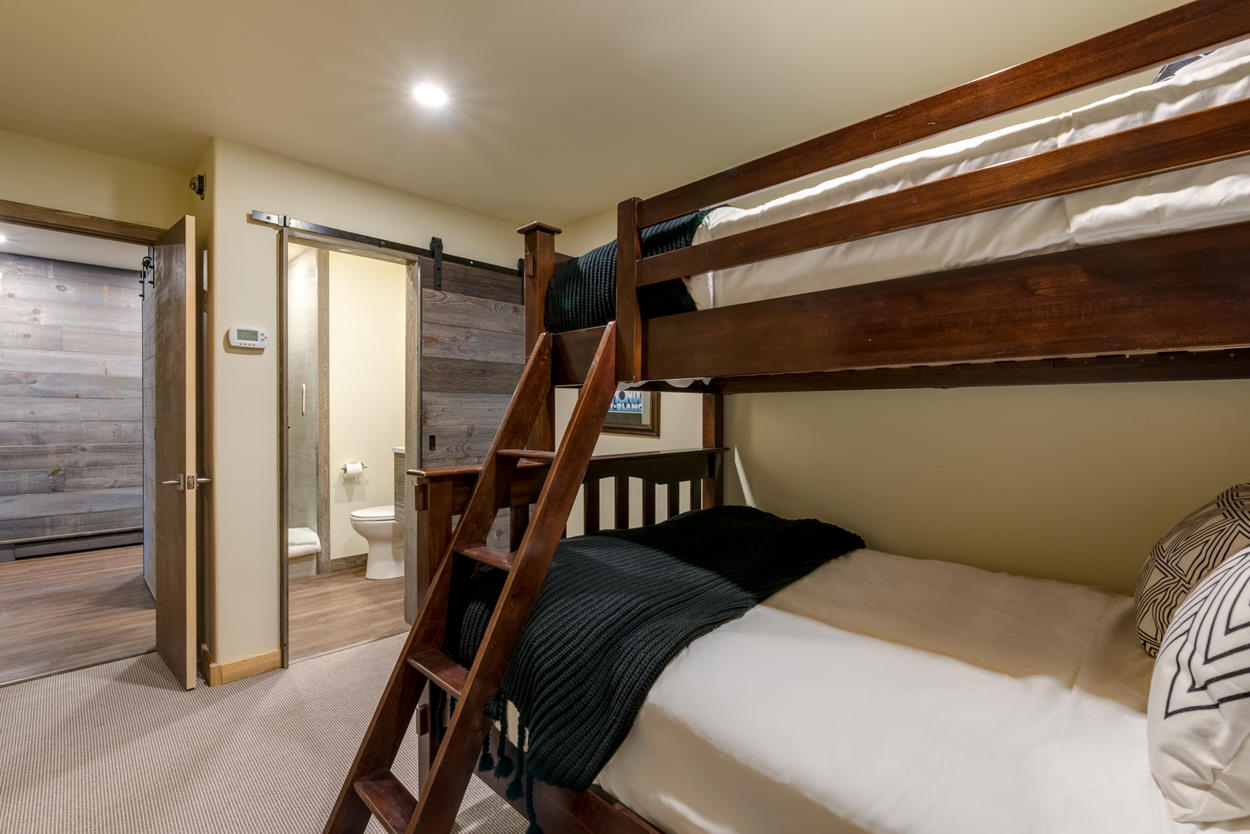 Also on the main level, Guest Bedroom 3 holds a captain's bunk