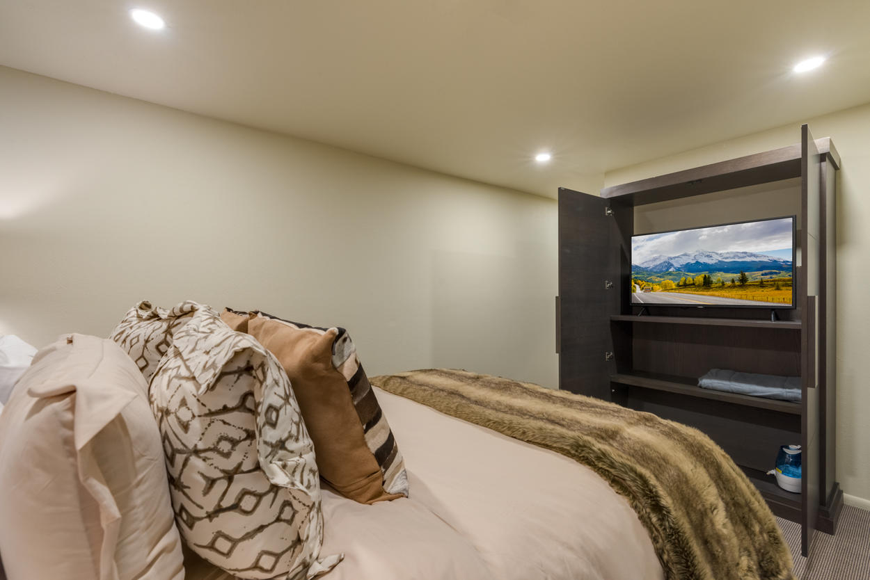 Guest Bedroom 2 has a flat screen hidden inside the cabinet, as well as an ensuite bathroom