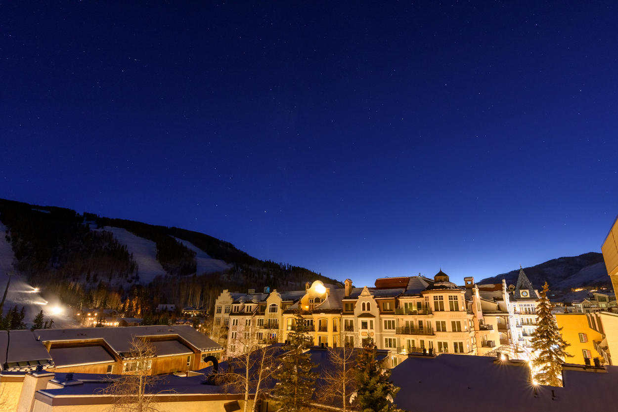 An evening view of the ski slopes and Vail Village.