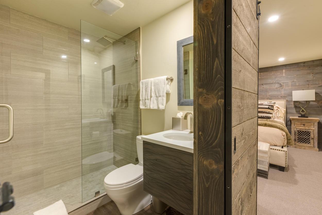 Guest Bathroom 2 is en suite and hosts a walk-in shower