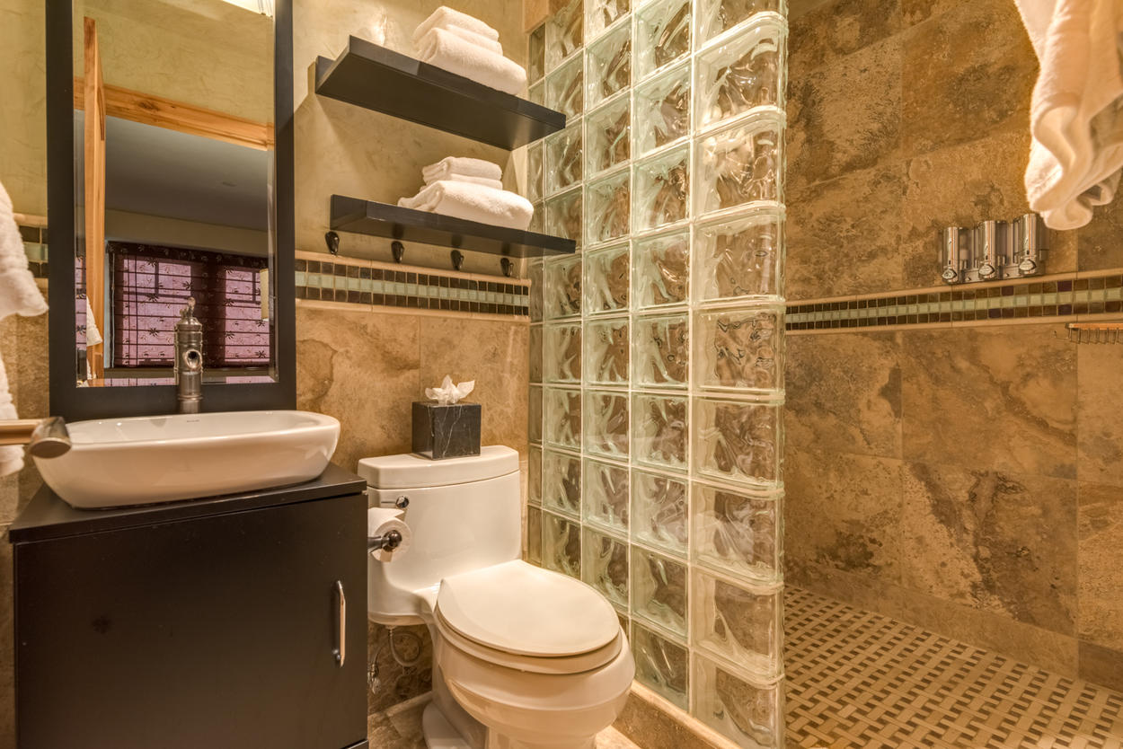 The ensuite for the Bunk Room offers a standalone shower