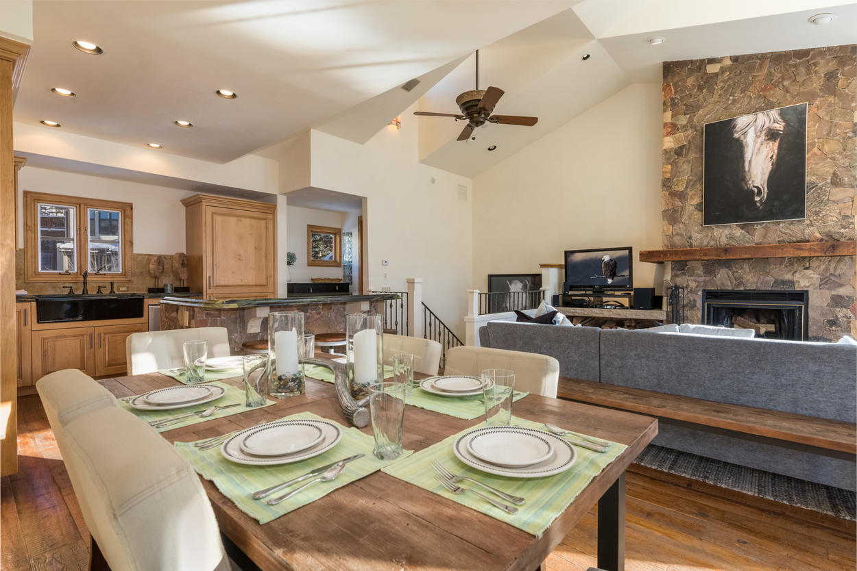 The dining area seats up to 6 guests in comfortable upholstered dining chairs