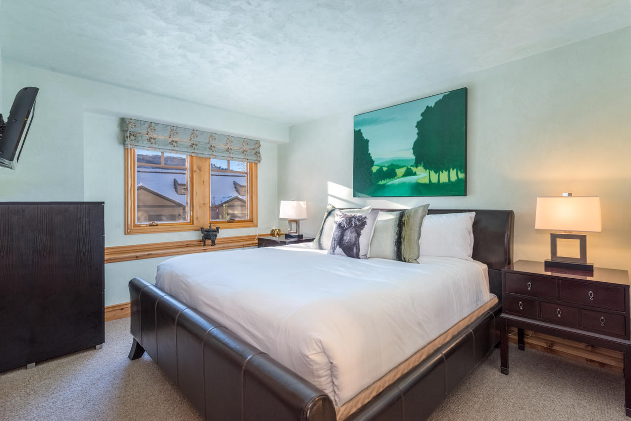 On the lower level of the home, Guest Bedroom 2 presents another King bed and flat screen tv