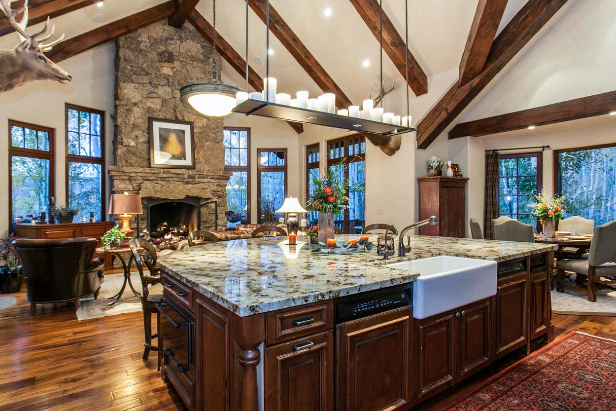 Granite countertops under a modern lighting feature creates a refreshing setting for preparing a meal