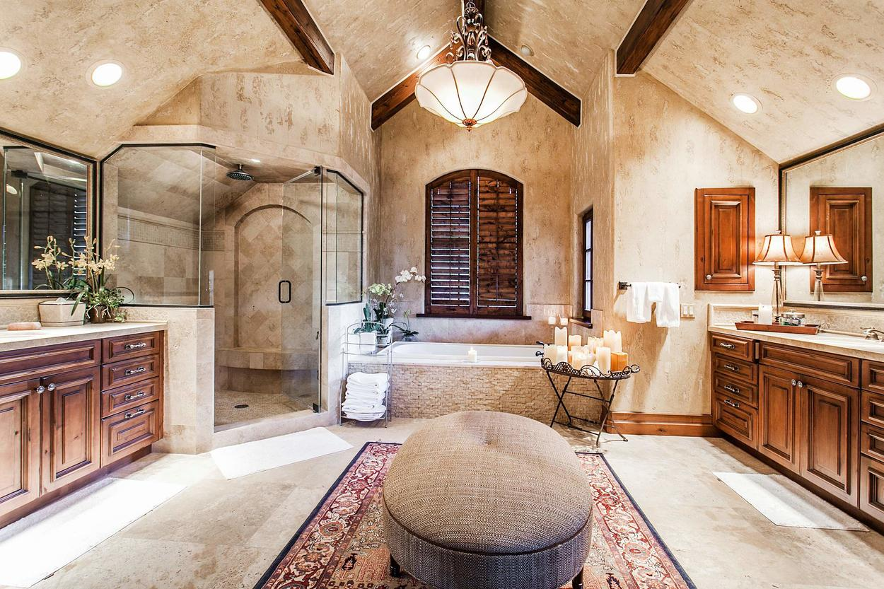 The Master Bathroom is enormous and features two vanities, a stand alone steam shower and soaking tub