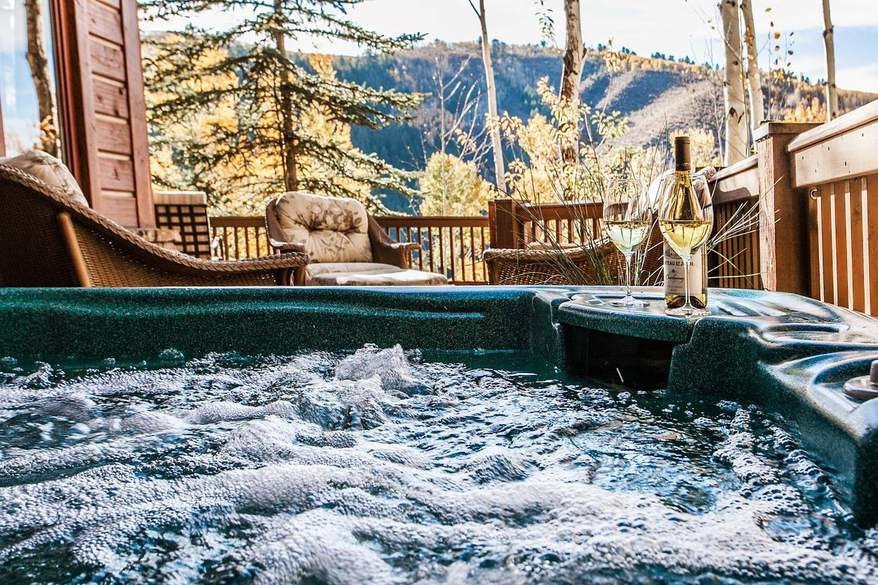 Enjoy mountain views from the warmth of your private hot tub
