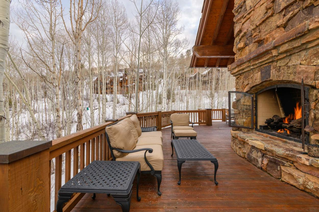 Tthe outdoor fireplace is sure to raise the ambiance level of a night spent enjoying a quiet glass of wine on the deck