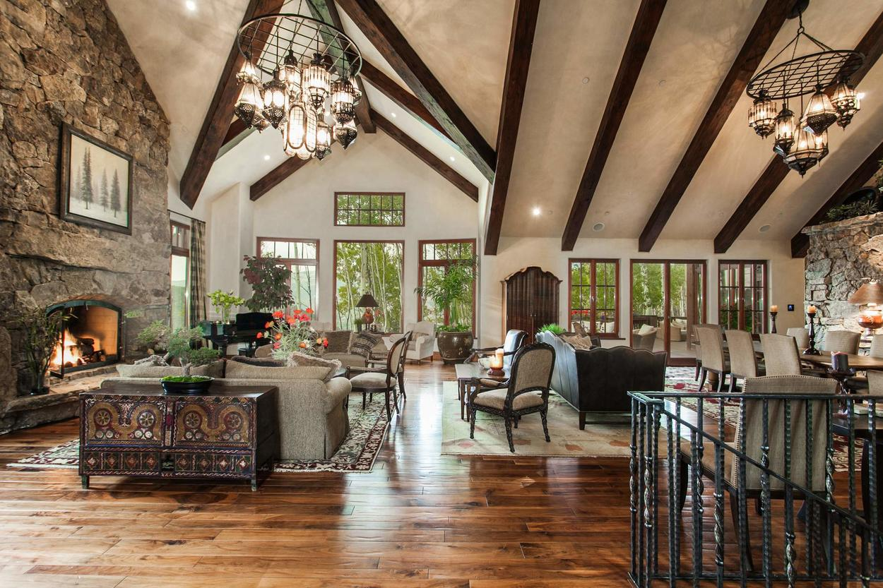 The Great Room is exquisitely designed, with cathedral ceilings and exposed beams adding to the vertical space