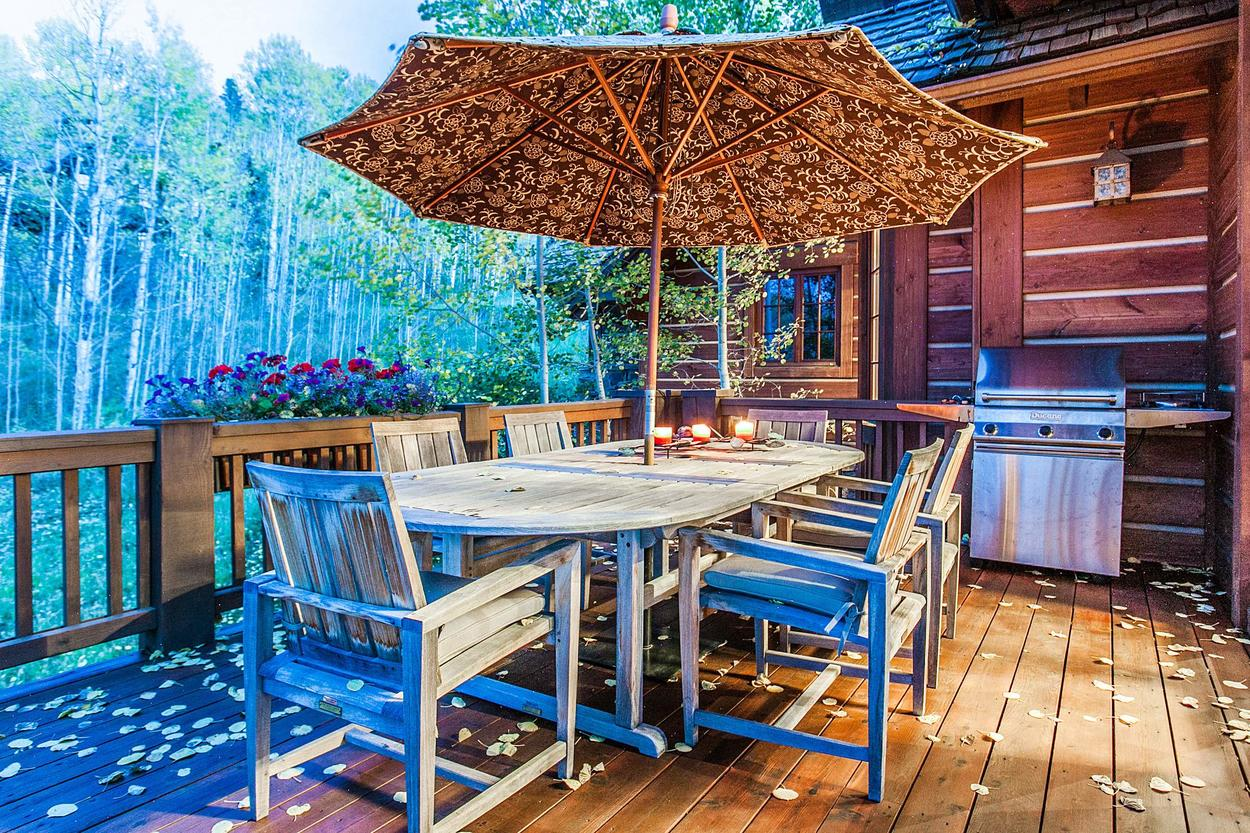 There's nearly as much outdoor living space as indoors, including an outdoor dining area by the gas grill