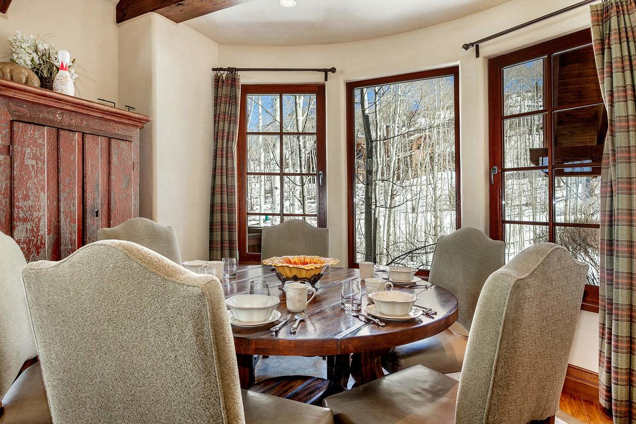 The breakfast area off of the kitchen features views of aspens and seats up to 6
