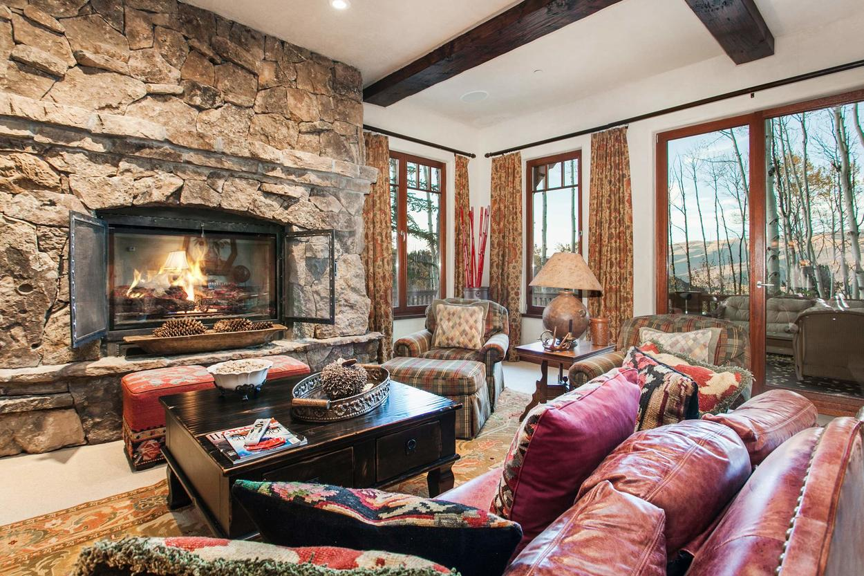 Watch the sunset from the lower-level Family Room as you enjoy the fireplace